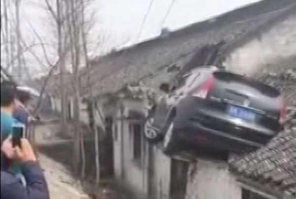 Watch Out Of Control Driver In China Crashes Car Onto