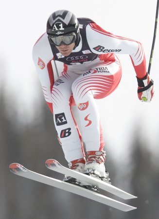 Walchhofer wins men's super-G in snowstorm