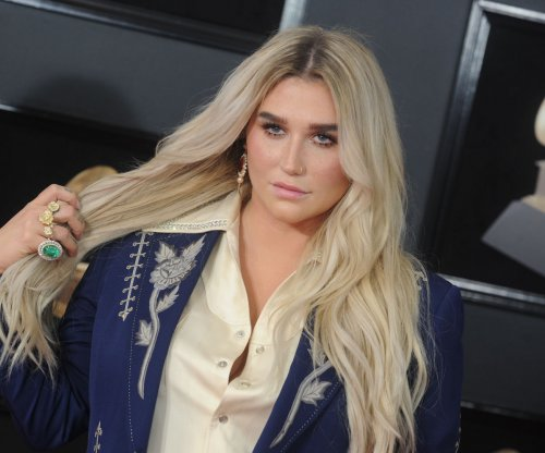 Kesha postpones spring tour dates due to injury