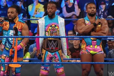 WWE Smackdown: New Day celebrate Kofi Kingston's championship win