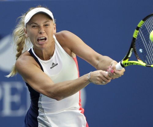 Caroline Wozniacki continues magical run, advances to quarters at U.S. Open