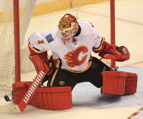 Back from illness, Brian Elliott leads Calgary Flames past Dallas Stars