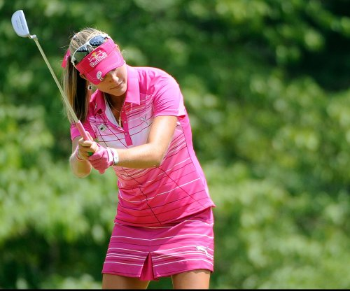 Women's golf fan tattles on Lexi Thompson, Tiger Woods fires back