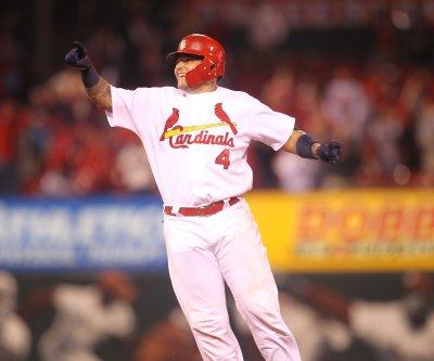 Yadier Molina's controversial RBI double lifts St. Louis Cardinals past Cincinnati Reds