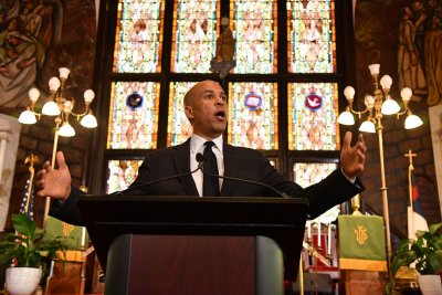 At victimized Charleston church, Cory Booker condemns violence, racism