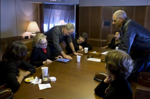 George W. Bush shows off paintings while traveling on Air Force One