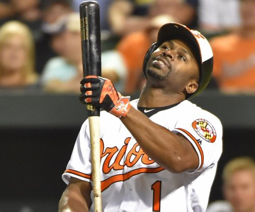 Baltimore Orioles OF Michael Bourn breaks finger playing catch with football