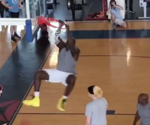 NBA legend Shaquille O'Neal plows defender in Boston gym