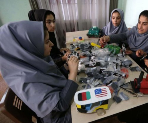 Afghan girls travel to Washington for robotics competition