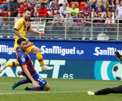 Barcelona's Lionel Messi nutmegs defender for goal against Eibar