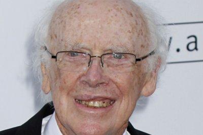 Buyer plans to return Nobel medal to James Watson