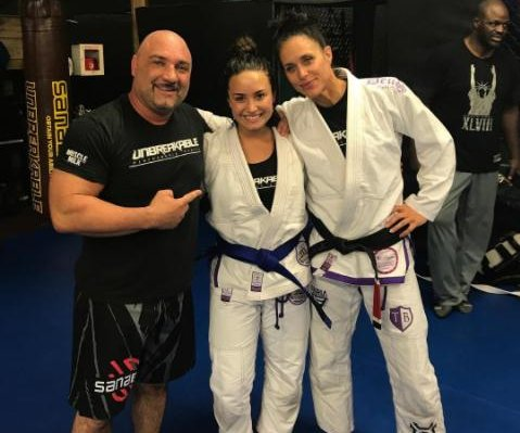 Demi Lovato earns her blue belt in Brazilian jiu-jitsu