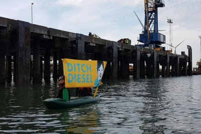 Protesters storm cargo ship to keep VW diesel vehicles out of Britain