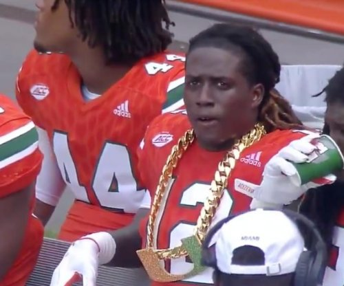 Miami Hurricanes give DB Malek Young giant gold chain after interception