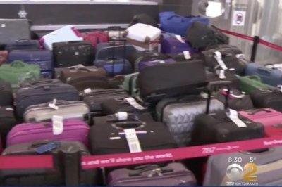 Water main breaks, flooding airport terminal at chaotic JFK