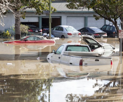 Thousands return to California homes after flood, prep for more storms