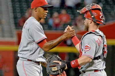Reds look to continue to confound Cubs