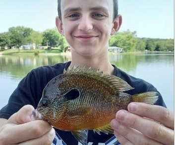 Missouri boy's 5-ounce sunfish breaks state record set by his dad
