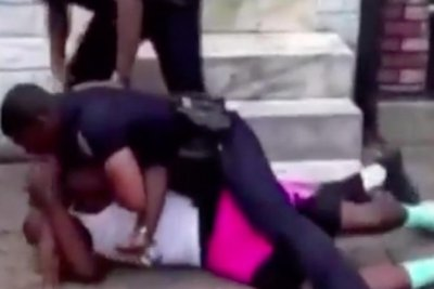 Baltimore police officer seen beating man on video charged with assault