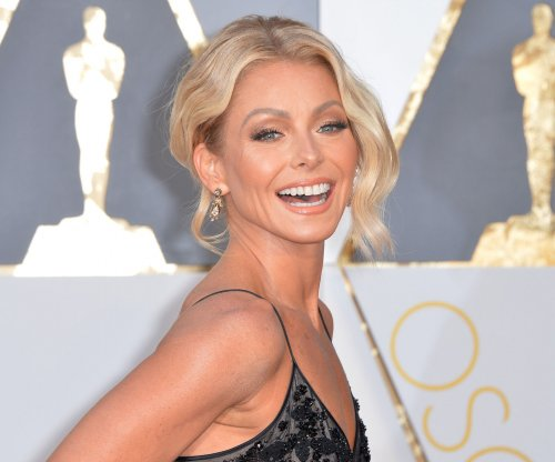 Kelly Ripa returns to 'Live!' and declares, 'Our long, national nightmare is over'