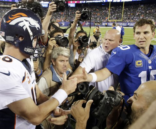 Peyton Manning watches game film with Eli Manning, New York Giants