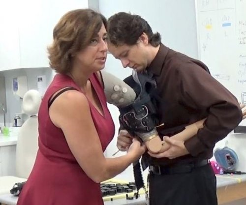 Prosthetic arm with realistic sensation makes 'life a better place'