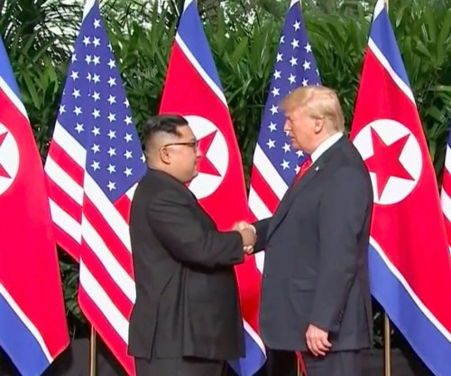 Trump gives Kim a 'thumbs up' after initial handshake