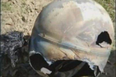Satellite fuel tank crashes down on California orchard