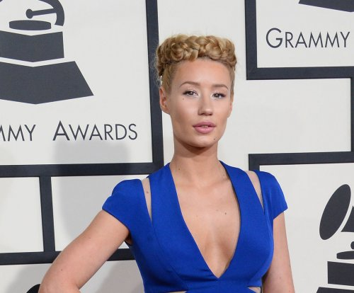 Iggy Azalea demands explanation from Papa John's after phone number is leaked