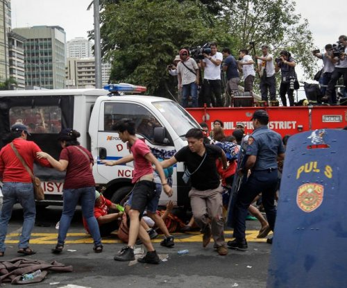 Philippine police van mows down people during violent anti-U.S. military protest