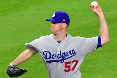 Suarez, Wood go to battle for Giants, Dodgers