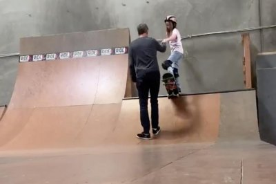 Tony Hawk teaches daughter skateboarding drop-in