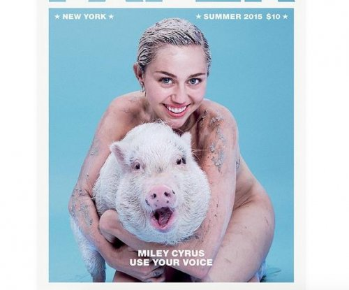 Miley Cyrus poses nude with pig for Paper