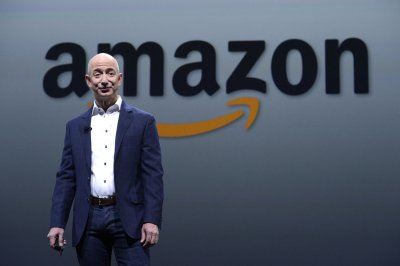 Amazon sees brisk sales, profits are still skimpy