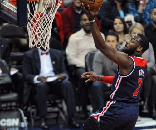 John Wall helps Washington Wizards snap skid against New York Knicks