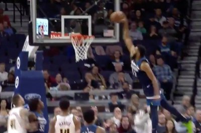 Karl-Anthony Towns towers on dunk over Paul Millsap