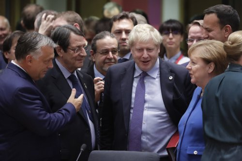Boris Johnson returns to London to sell lawmakers new Brexit deal