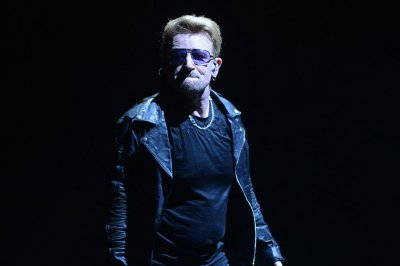 U2 and Eagles of Death Metal share the stage in Paris