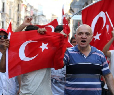 Arrest warrants issued for journalists after failed Turkey coup
