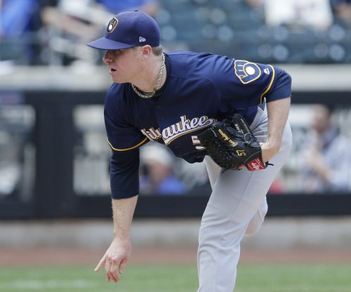 Chase Anderson's hot pitching leads Milwaukee Brewers over San Francisco Giants