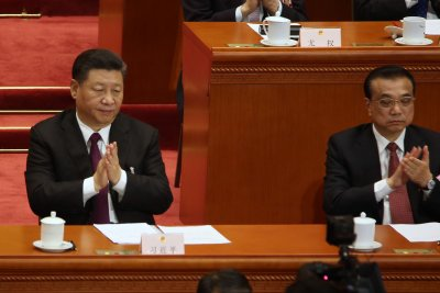China's Xi Jinping re-elected with VP ally, no term limits