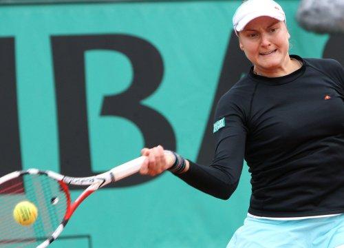 Petrova, Ivanovic win in upsets in Bali