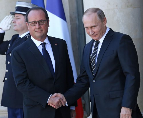 Putin meets with Hollande, Merkel on Ukraine