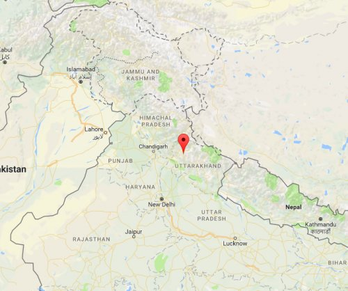 Bus in India plunges into gorge killing 21