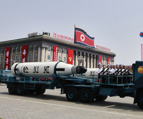 North Korea displays new missiles in military parade