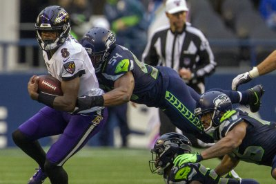 Ravens QB Lamar Jackson runs over Seahawks