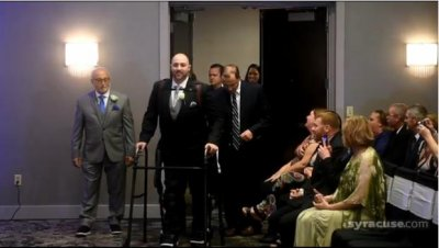 Paralyzed groom walks down aisle with exoskeleton