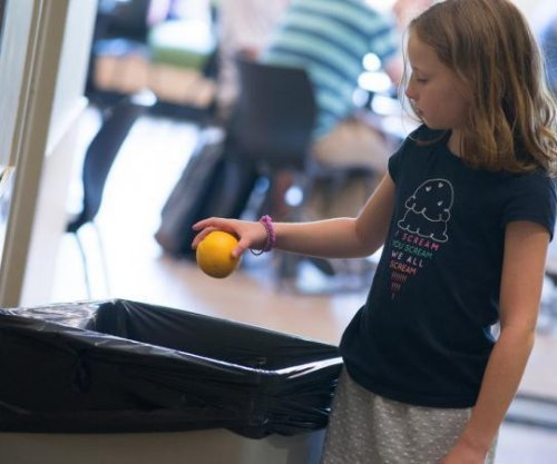 Children throwing away fruit, vegetables from school lunches
