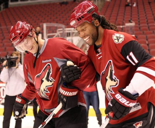 Watch: Larry Fitzgerald looks shaky on skates at Arizona Coyotes practice