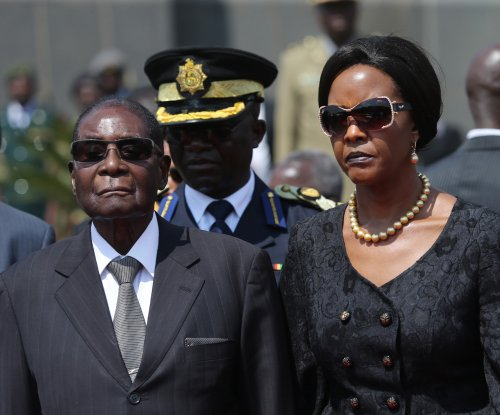 Zimbabwe president under arrest as military denies takeover is coup